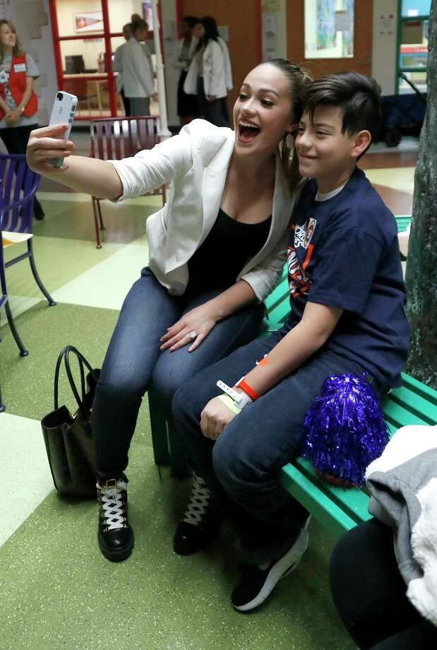 Daniella Rodriguez, fiance of Houston Astros Carlos Correa takes a photo with Byron Ramirez, 12, as they visited patients at the Children's Memorial Hermann Hospital on Tuesday, Nov. 14, 2017, in Houston. Photo: Karen Warren, Houston Chronicle / © 2017 Houston Chronicle