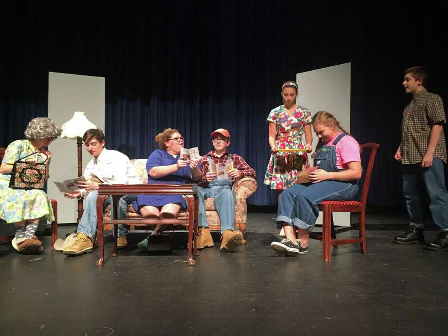 """From left, Gillian Chadderton, David O'Brien, Mya Ginsberg, Dan Gallipoli, Shelby Gagne, Miranda Burrows and  Andrew Brown in the West Haven High School Theatre Workshop production of """"Dearly Departed."""" Photo: Contributed Photo"""