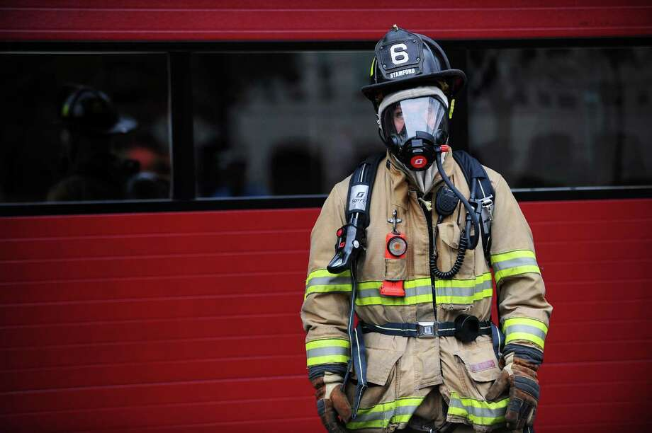 Fire fighter Jon Lund wears the new Air-Pak X3 breathing apparatus, which will soon be used by Stamford firefighters across the city, at the Stamford Fire Department Headquarters on Main Street in Stamford, Conn. on Tuesday, Nov. 14, 2017. Photo: Michael Cummo / Hearst Connecticut Media / Stamford Advocate