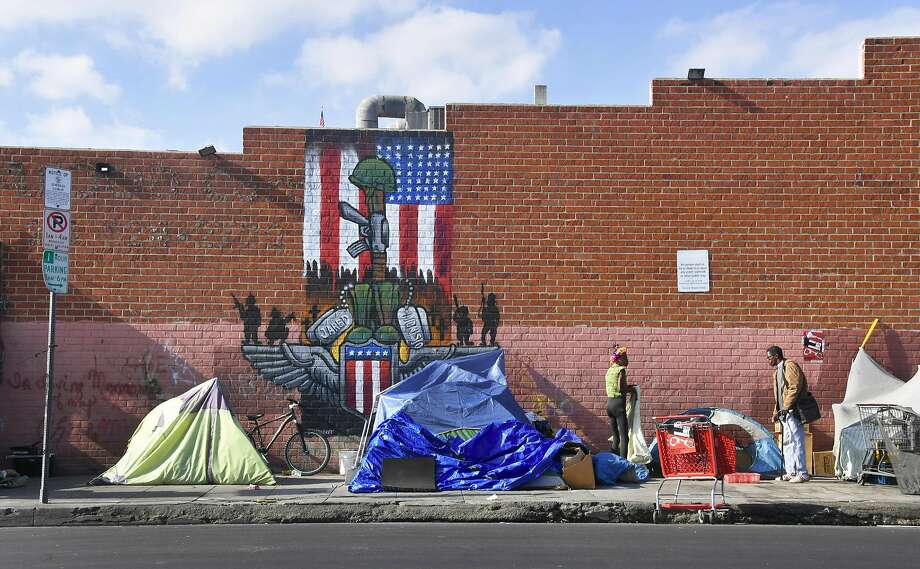 Makeshift tents house the homeless on Nov. 10, 2017, on a street in Los Angeles street, home to one of the nation's largest homeless populations. About a third of those living on the streets have mental illness. Photo: FREDERIC J. BROWN, AFP/Getty Images
