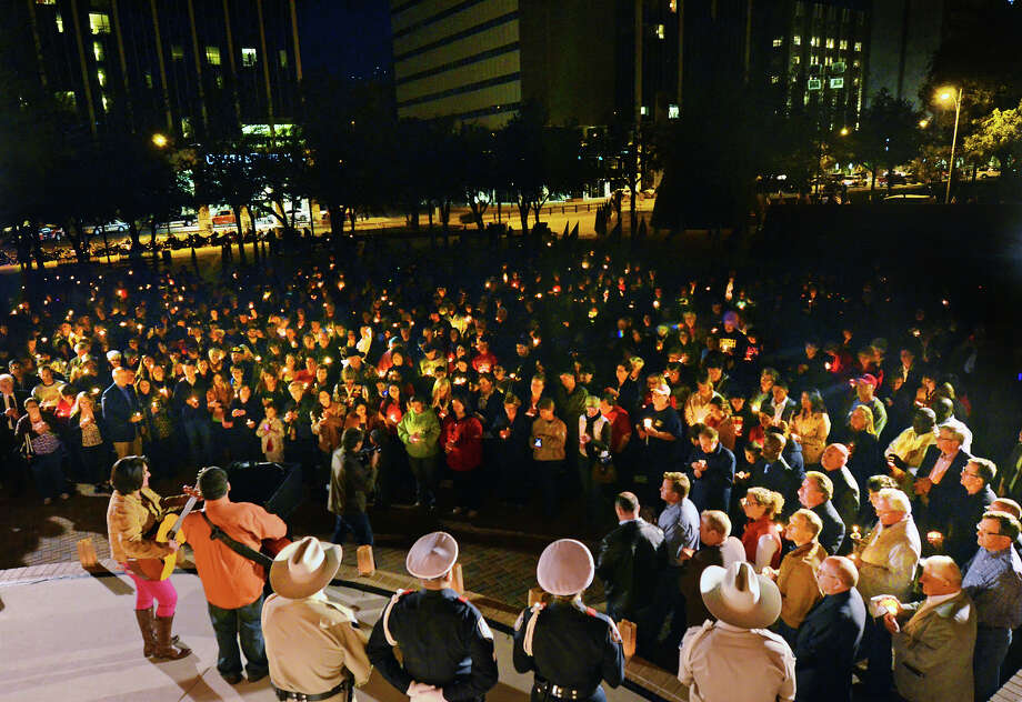 Midlanders gather in Centennial Plaza Saturday for a candlelight vigil held in honor of four veterans who were killed when a freight train hit a parade float Thursday. James Durbin/Reporter-Telegram Photo: JAMES DURBIN/Midland Reporter-Telegram
