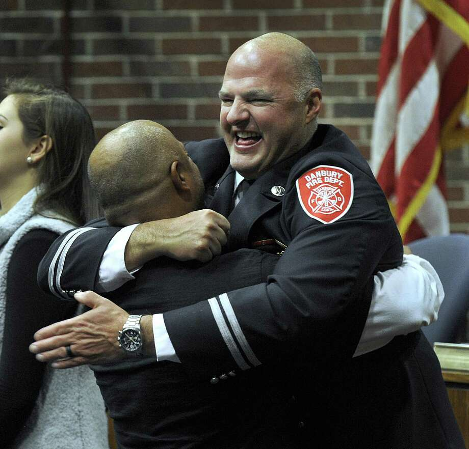 Deputy Chief Joe Halas gets a bear hug from his friend Danbury Police Det. Luis Ramos after Halas was sworn in as Deputy Chief of the Danbury Fire Department in a ceremony at City Hall Tuesday morning, Nov. 14, 2017. Photo: Carol Kaliff / Hearst Connecticut Media / The News-Times