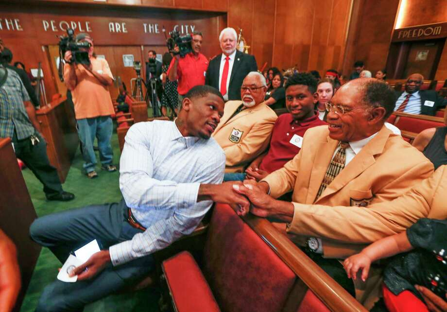 "Andre Johnson, former Texans wide receiver, shakes hands with NFL Hall of Famers and chats with Elvin Bethea before he was honored with ""Andre Johnson Day"" by the City of Houston  Tuesday, Nov. 14, 2017, in Houston. Photo: Steve Gonzales, Houston Chronicle / © 2017 Houston Chronicle"