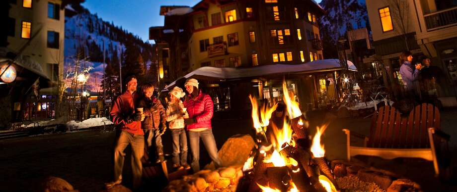 People gather around a fire pit in Squaw Valley, which saw a major overhaul of High Camp, it's mid-mountain facility, with a revamp of Terrace Restaurant & Bar and the former Poolside Cafe, both of which will open by the holidays. Photo: Jeff Dow