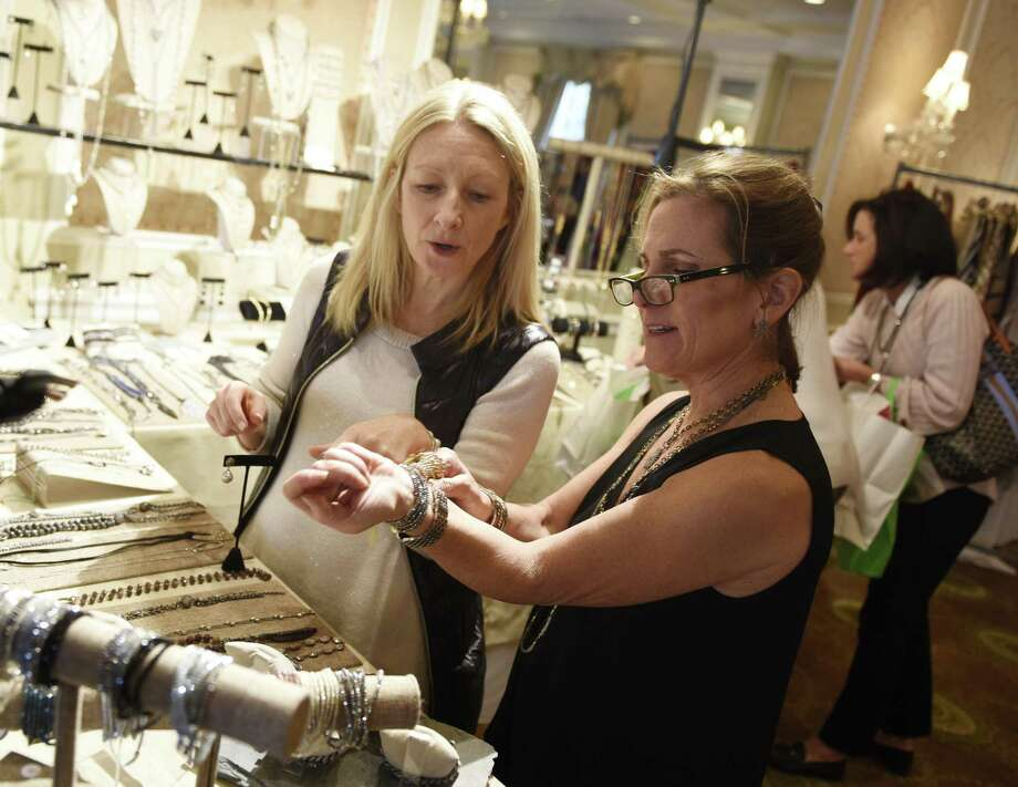 Ilyse's Pieces vendor Ilyse Ennis, right, shows her jewelry to Greenwich resident Emma Pennington at the Breast Cancer Alliance Holiday Gift Boutique at the Greenwich County Club in Greenwich, Conn. Tuesday, Nov. 14, 2017. Artisans, designers and other local merchants displayed their goods for folks to browse and buy. The sale continues Wednesday from 9 a.m. to 3 p.m. with a special reserved lunch optional from 12:30 p.m. to 2:30 p.m. Photo: Tyler Sizemore / Hearst Connecticut Media / Greenwich Time