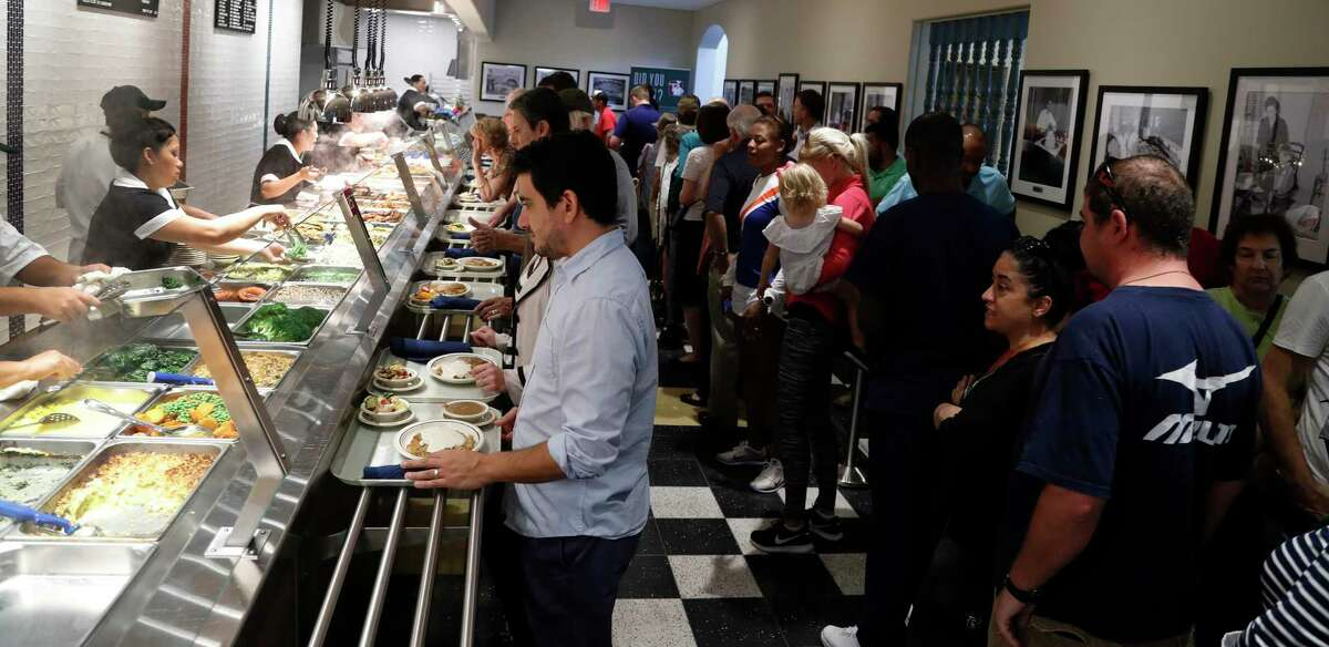 Cleburne Cafeteria with a line of people, during their soft opening, Tuesday, Nov. 14, 2017, in Houston. Cleburne Cafeteria, which was destroyed by fire in 2016, now features several upgrades including a patio, the ability to order wine and beer and some menu additions. ( Karen Warren / Houston Chronicle )