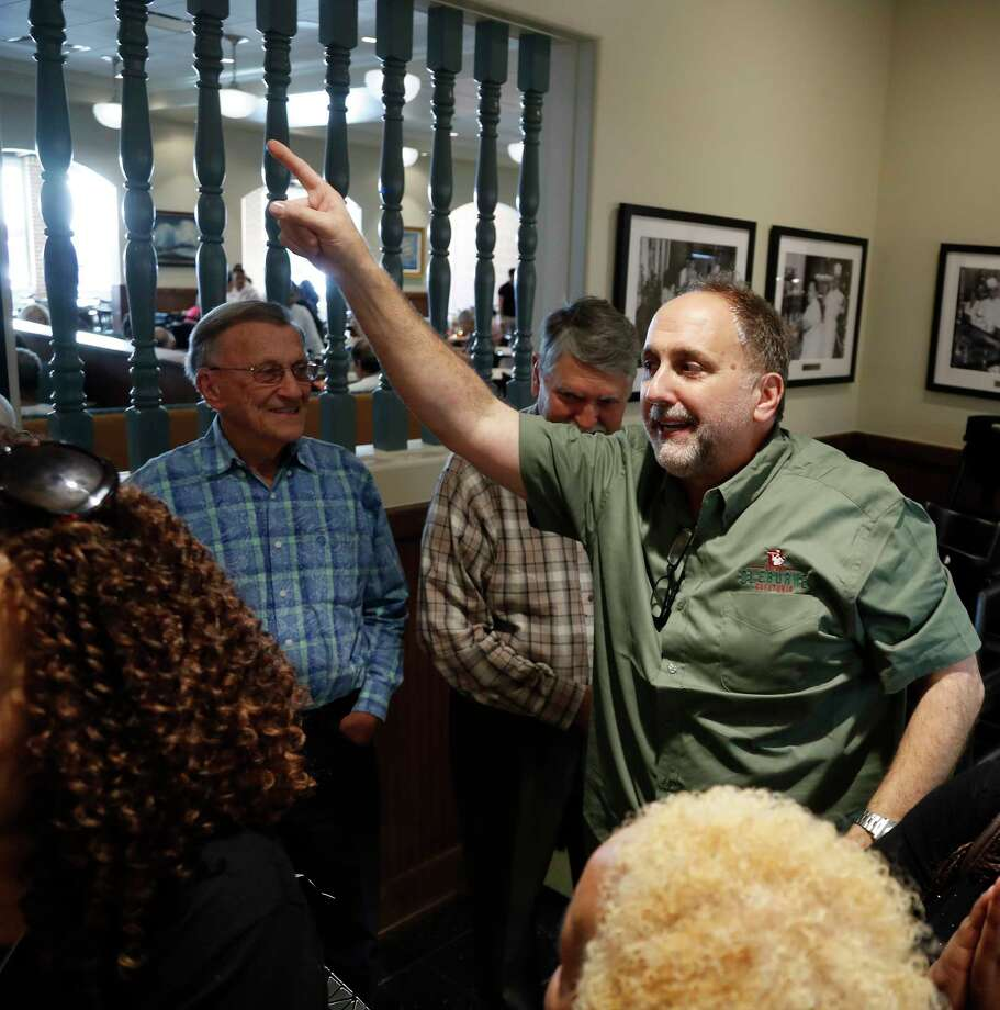 Cleburne Cafeteria owner George Mickelis greets customers standing in line during their soft opening, Tuesday, Nov. 14, 2017, in Houston.  Cleburne Cafeteria, which was destroyed by fire in 2016, now features several upgrades including a patio, the ability to order wine and beer and some menu additions.  ( Karen Warren / Houston Chronicle ) Photo: Karen Warren, Staff / © 2017 Houston Chronicle