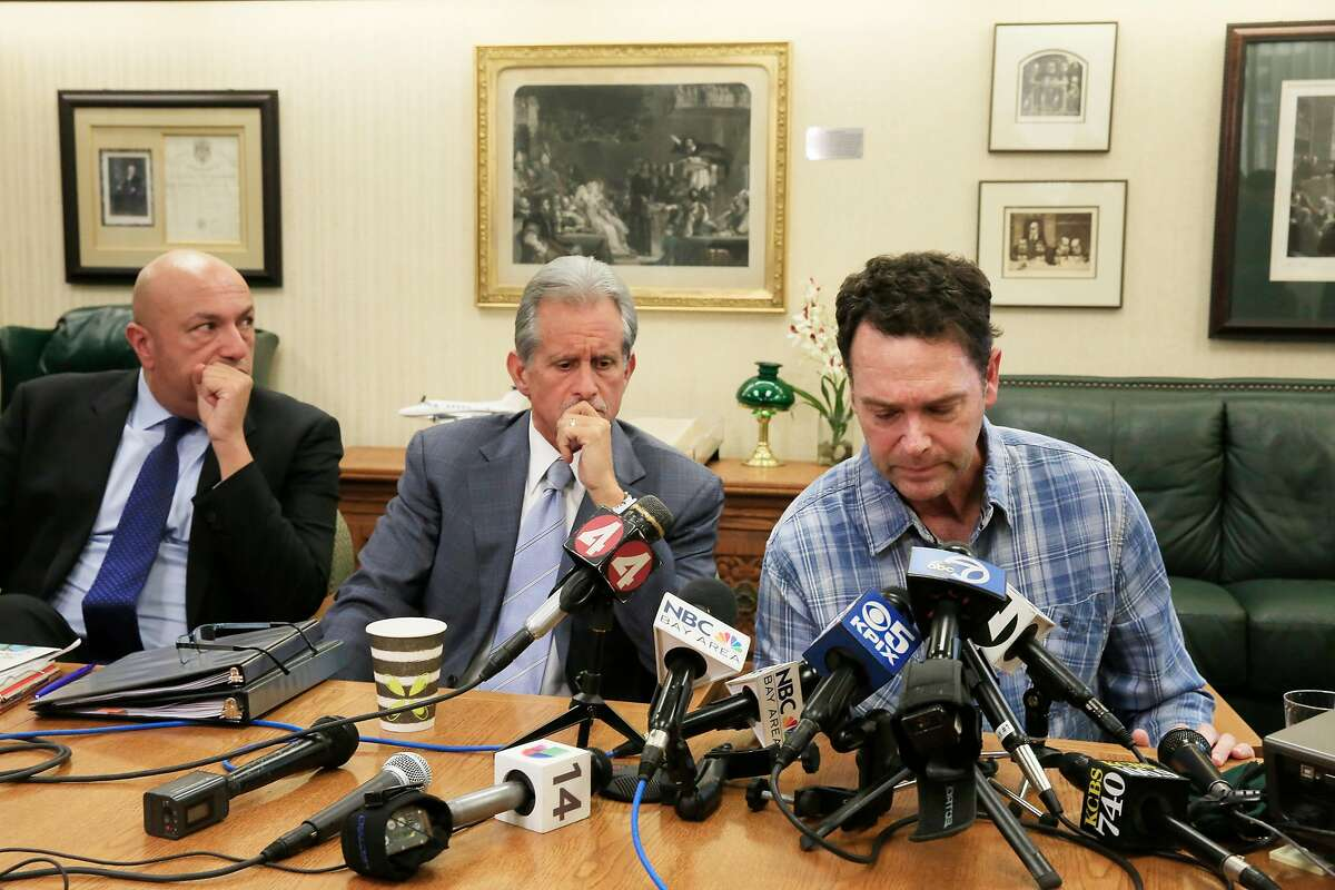 Greg Wilson (right), Sonoma County resident who lost his home in the North Bay fires, speaks during a press conference at Cotchett, Pitre & McCarthy as Frank Pitre (center), attorney Cotchett, Pitre & McCarthy, LLP and Khaldoun Baghdadi (left), attorney, Walkup, Melodia, Kelly & Schoenberger listen to Wilson speak at Cotchett, Pitre & McCarthy where lawsuits filed against PG &E on behalf of North Bay fire victims were announced on Tuesday, November 14, 2017 in Burlingame, Calif.