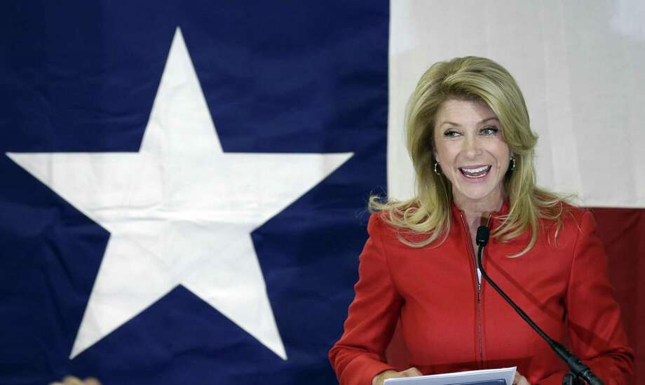 File - In this March 4, 2014 file photo, Texas Sen. Wendy Davis, D-Fort Worth, speaks to supporters at her campaign headquarters, in Fort Worth, Texas. Davis' compelling personal story of rising from a trailer park to Harvard Law has reeled in donors. She now has financial backers in every U.S. state. (AP Photo/LM Otero, File) Photo: LM Otero, STF / AP / AP