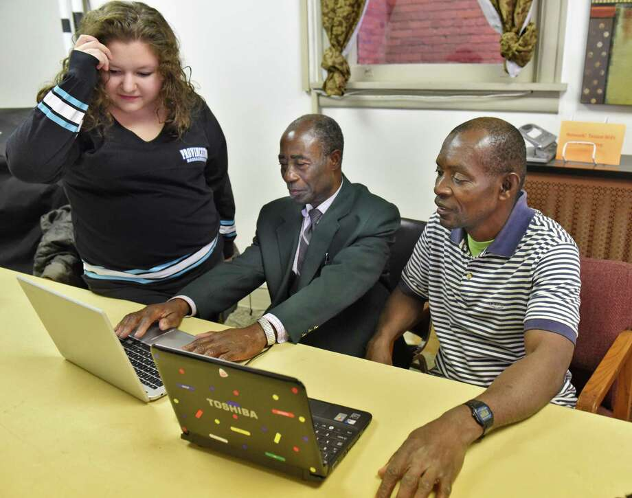 Russell Sage student Sydney Mohr, left, works with West African immigrants Niangoran Clement, and Kodzotse Dzikunu, right, in a computer literacy class at Literacy Volunteers of Rensselaer Tuesday Nov. 1, 2016 in Troy, NY.  (John Carl D'Annibale / Times Union) Photo: John Carl D'Annibale / 20038627A