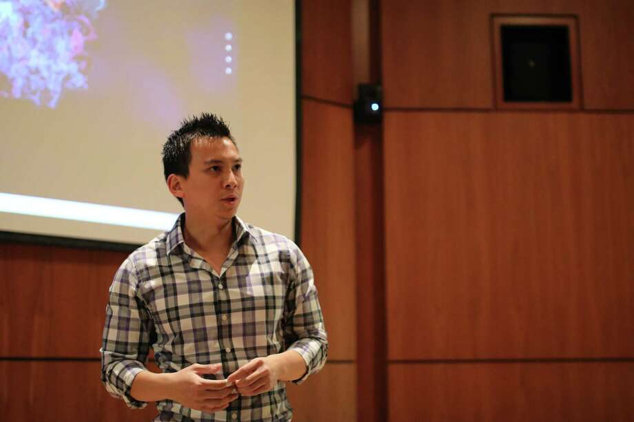 Tony Hoang, who came to the U.S. as a child refugee from Viet Nam, speaks to children from the Boys and Girls clubs of Albany and Troy during an event at the University at Albany to encourage the study of science and technology.