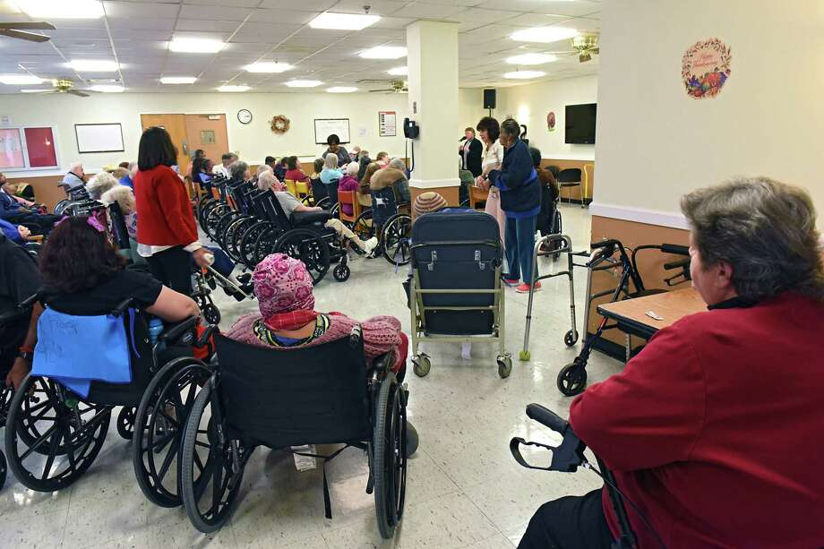 Residents listen to a performer sing in a community room at the Albany County Nursing Home on Monday, Nov. 21, 2016 in Colonie, N.Y. (Lori Van Buren / Times Union) Photo: Lori Van Buren / 20038864A