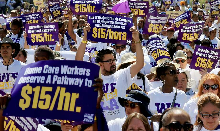 Hundreds of Los Angeles home care workers march for a higher minimum wage, now $10.50 in California. Photo: Luis Sinco, LA Times Via Getty Images