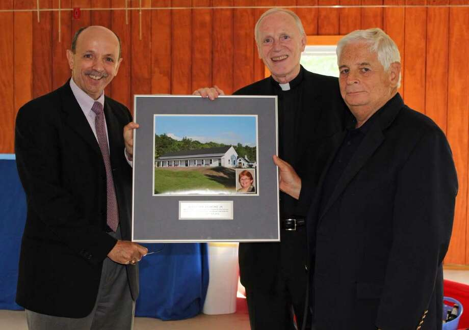 From left, Catholic Charities CEO Vince Colonno, Bishop Emeritus Howard Hubbard and Prime Properties CEO Ken Raymond at the dedication of the Camp Scully dining hall in 2012. (Courtesy of Catholic Charities)