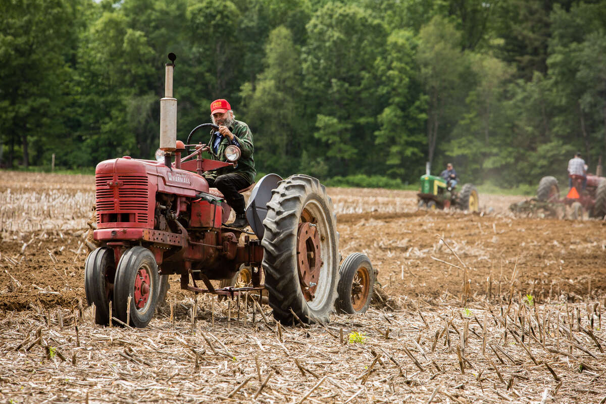 Antique tractor enthusiasts plowed the Pitney Meadows Community Farm in the spring of 2017. (Photo: Pattie Garrett)