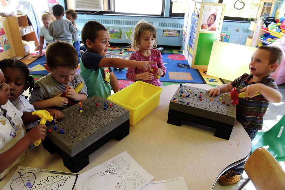 Children play in the pre-school class at A Child's Place at Unity House on Wednesday, Oct. 18, 2017, in Troy, N.Y.  (Paul Buckowski / Times Union) Photo: PAUL BUCKOWSKI / 20041860A