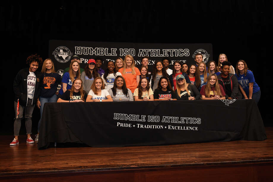 Humble ISD athletes pose for a group photo during the HISD Signing Day Ceremony at Charles Bender Performing Arts Center in Humble on Nov. 8, 2017. (Photo by Jerry Baker/Freelance) Photo: Jerry Baker, For The Chronicle / Freelance