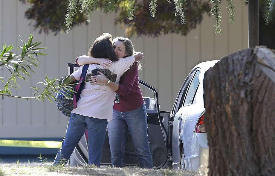 Two women embrace outside Rancho Tehama Elementary School, where a gunman opened fire Tuesday, Nov. 14, 2017, in Corning, Calif. Authorities said, a gunman choosing targets at random, opened fire in a rural Northern California town Tuesday, killing four people at several sites and wounding others at the elementary school before police shot him dead. (AP Photo/Rich Pedroncelli) Photo: Rich Pedroncelli, Associated Press