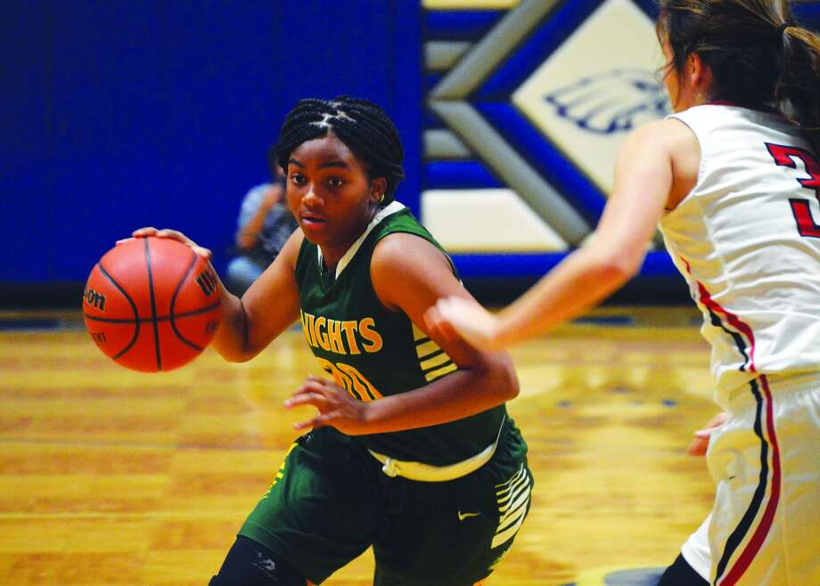 Metro-East Lutheran sophomore guard Destiny Williams drives to the basket during the first quarter of Monday's game against Triad.