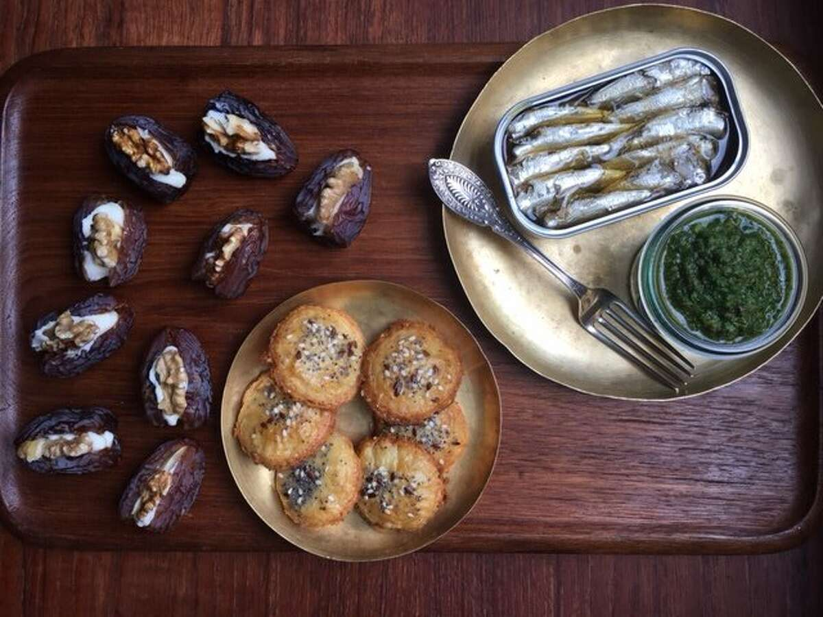 Jessica Battulana's snacks for Thanksgiving are Tinned Sardines with Mint-Parsley Salsa Verde, top, Cheddar-Sage Crackers, and Stuffed Dates.