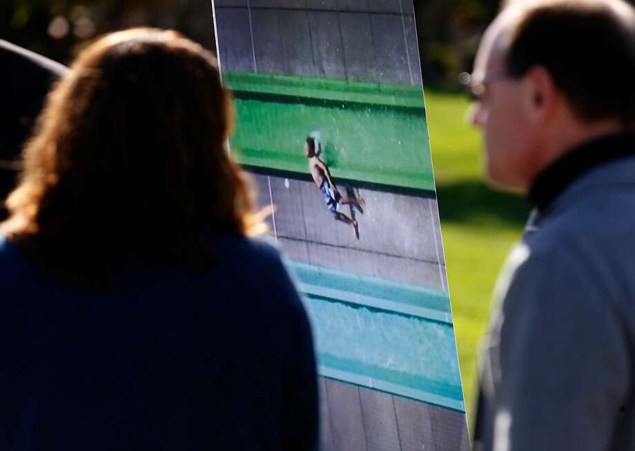 Parents Susanna Jones and Ron Hayduk stand near a video frame showing their son, Jamie, being ejected from the Emerald Plunge water slide on the opening day of the Wave Waterpark in Dublin in May. Photo: Michael Macor, The Chronicle