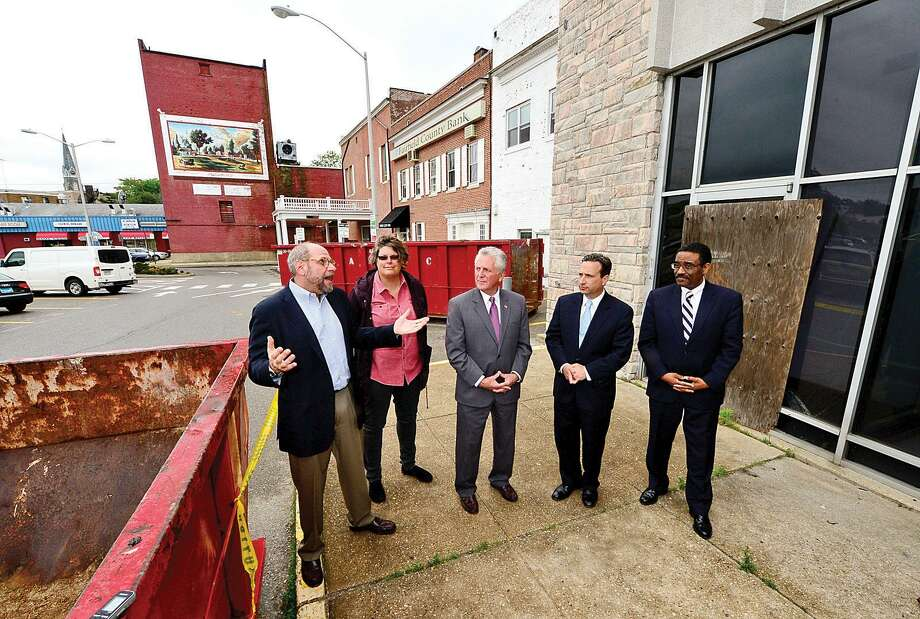 Hour file photo / Erik Trautmann CEO of POKO Partners, Kenneth Olson, Norwalk Center Task Force chair Jackie Lightfield, Norwalk Mayor Harry Rilling, State Senator Bob Duff and State Representative Bruce Morris announce the beginning of environmental remediation and demolition work for the Wall Street Place development during a press conference Wednesday on Isaacs Street. Photo: File Photo / Hearst Connecticut Media File Photo / Norwalk Hour file photo