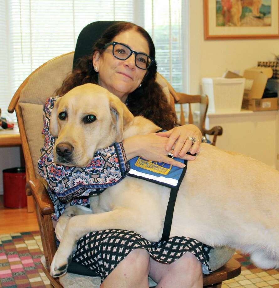 Psychologist Nancie Spector with her facility dog Robert at her home office in New Canaan on Nov. 9. Photo: Erin Kayata / Hearst Connecticut Media / New Canaan News