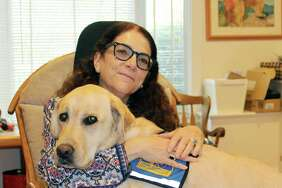 Psychologist Nancie Spector with her facility dog Robert at her home office in New Canaan on Nov. 9.