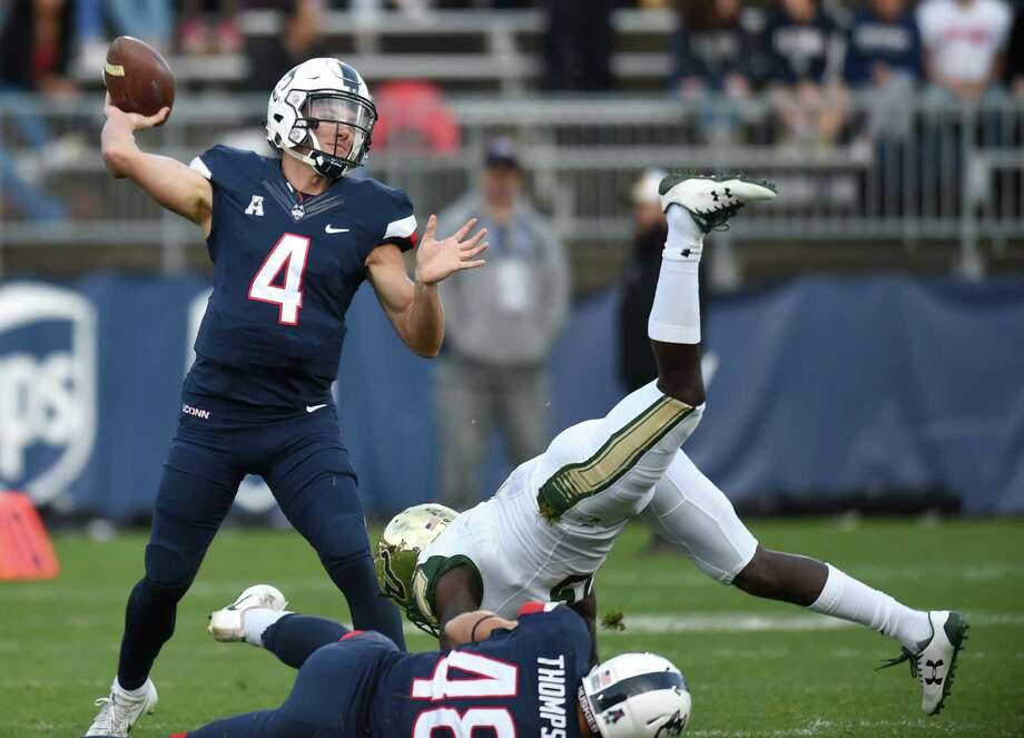 Bryant Shirreffs finishes his college career ranked in the top five of multiple UConn quarterback statistics. Photo: Brad Horrigan / Tribune News Service / Hartford Courant