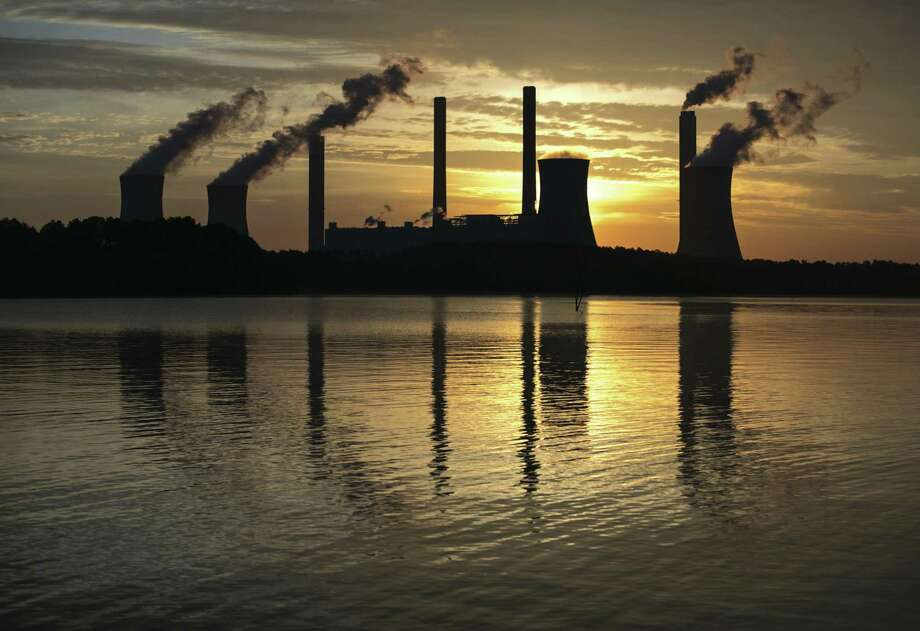 The National Climate Assessment undercuts the Trump administration on climate change. So where is the administration getting its information? Shown is the the coal-fired Plant Scherer in Juliette, Ga., a top carbon dioxide emitter in the U.S. Photo: Branden Camp /Associated Press / FR171034 AP
