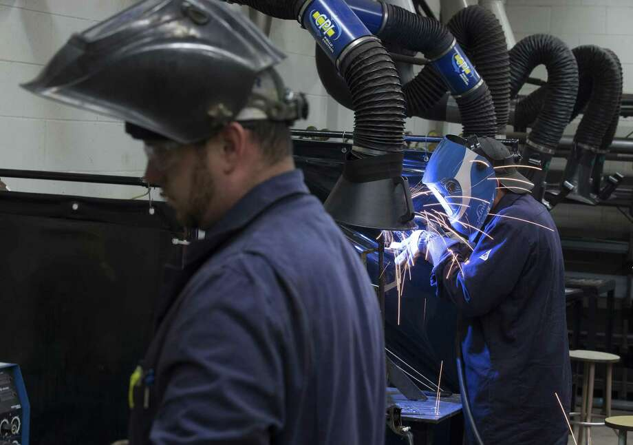 A student practices welding techniques at the vocational training centre in Montmagny, Quebec, Canada, on Oct. 31. The U.S. could learn — it, too, has jobs going empty for lack of skilled workers. Instead, however, lawmakers are about giving breaks to companies, not people, in tax reform. Photo: Christinne Muschi /Bloomberg / © 2017 Bloomberg Finance LP