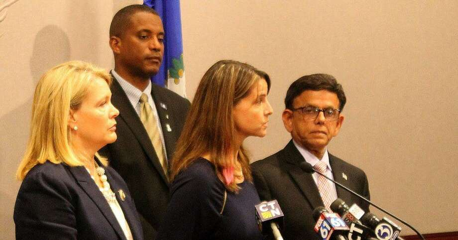 From left, state Sens. Heather Somers and George Logan and state Reps. Christie Carpino and Prasad Srinivasan speak during a press conference calling for a forum to address the recent allegations of patient abuse by Connecticut Valley Hospital employees in Middletown. Photo: Courtesy House Republicans