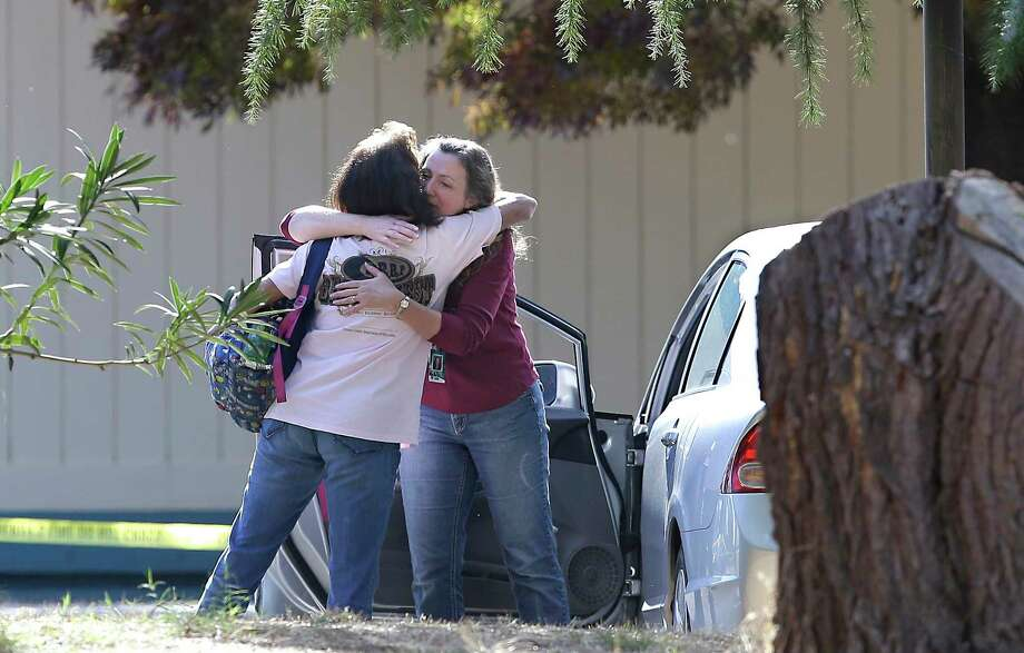 Women embrace outside Rancho Tehama Elementary School, where a gunman opened fire Tuesday. Four were killed before police shot the gunman dead. Photo: Rich Pedroncelli, STF / Copyright 2017 The Associated Press. All rights reserved.