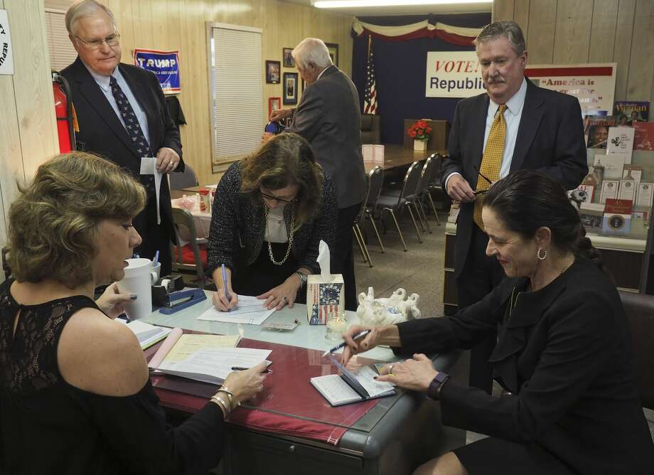 District judges Kyle Peeler, Elizabeth Leonard, David Lindemood and Robin Darr file their paperwork for re-election 11/14/17 morning with Sherri Merket at the Republican headquarters. Tim Fischer/Reporter-Telegram Photo: Tim Fischer/Midland Reporter-Telegram