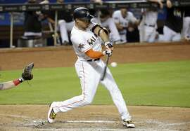 Miami Marlins' Giancarlo Stanton bats during a baseball game against the Cincinnati Reds, Friday, July 28, 2017, in Miami. The Marlins won 7-4. (AP Photo/Lynne Sladky)
