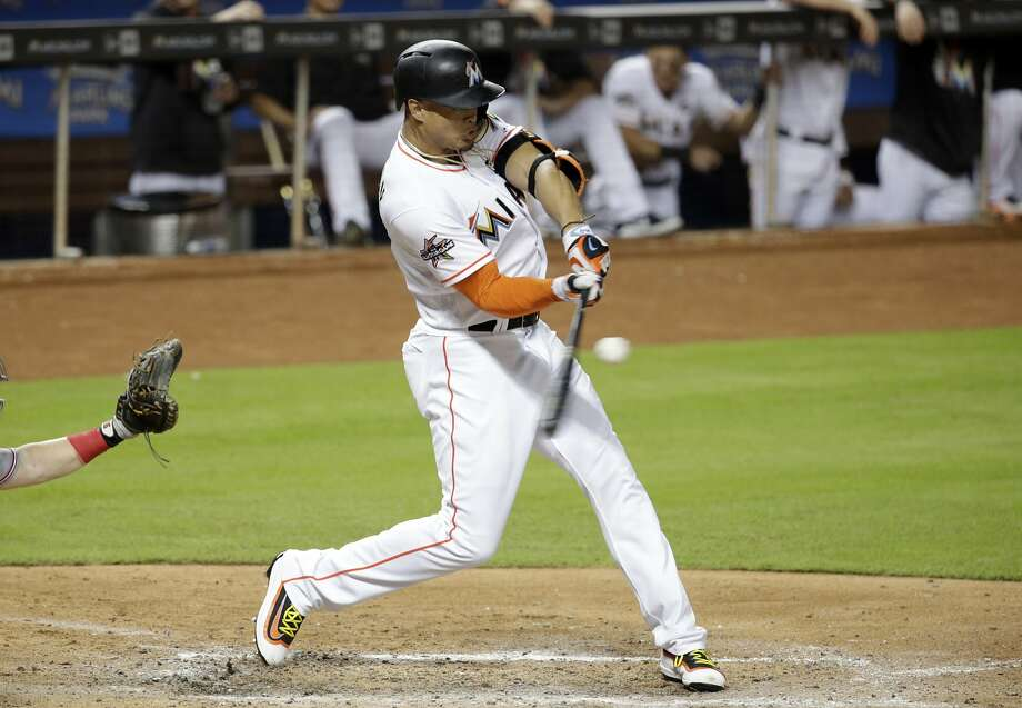 Marlins right fielder Giancarlo Stanton, seen batting during a July game against Cincinnati, hit 59 home runs last season in a career-high 159 games. The Giants as a team hit just 128. Photo: Lynne Sladky, Associated Press