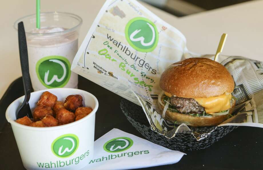 """TORONTO, ON- OCTOBER 23  The """"Our Burger"""", Sweet potato tots, and the Funky Monkey Adult Frappe at a Wahlburgers restaurant in Canada onNovember 15, 2014. Photo: David Cooper/Toronto Star Via Getty Images"""