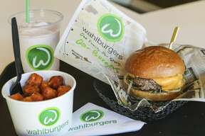 """TORONTO, ON- OCTOBER 23  The """"Our Burger"""", Sweet potato tots, and the Funky Monkey Adult Frappe at a Wahlburgers restaurant in Canada onNovember 15, 2014."""