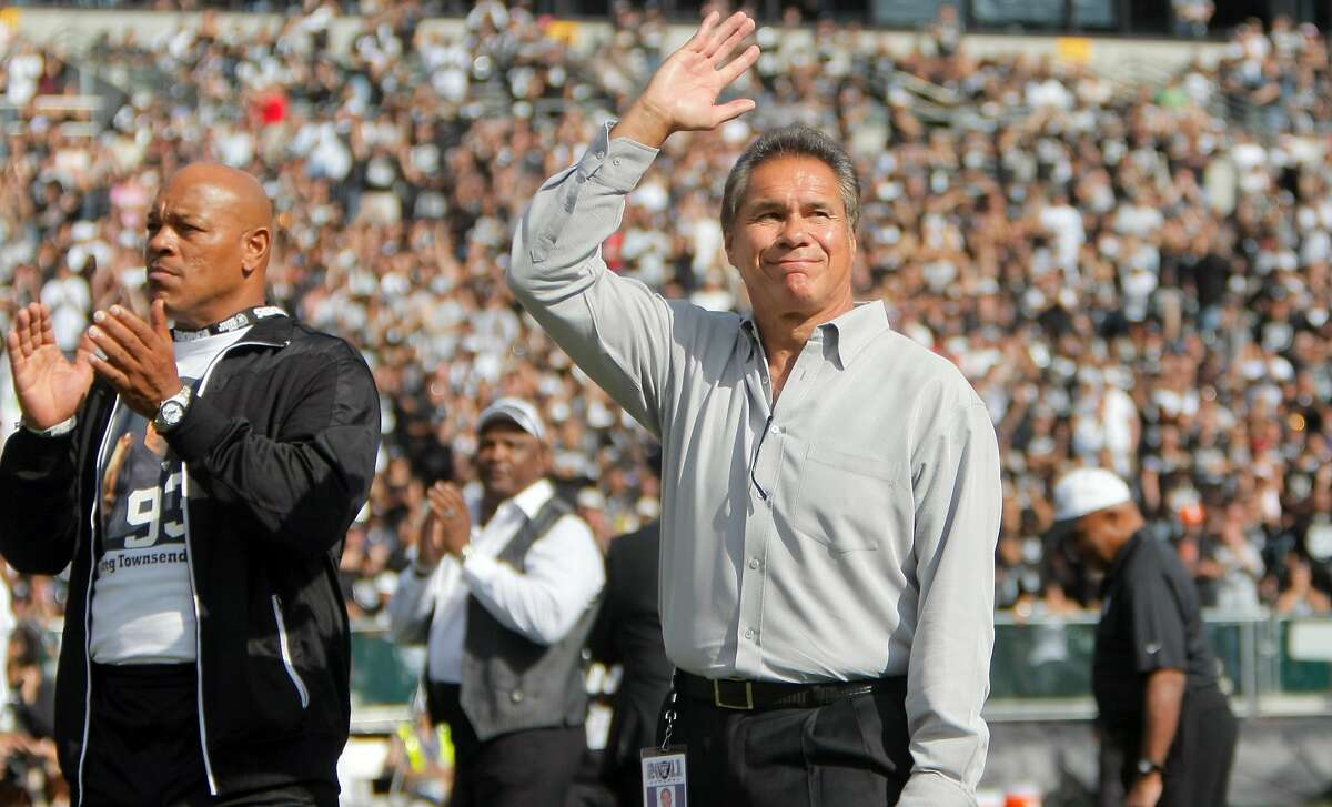 Former Raider Jim Plunkett waves to the crowd during a half time ceremony honoring Al Davis at the O.co Coliseum in Oakland. Calif., on Sunday, Oct. 16, 2011. The Raiders would win the game, 24-17.Former Raider Jim Plunkett waves to the crowd during a half time ceremony honoring Al Davis at the O.co Coliseum in Oakland. Calif., on Sunday, Oct. 16, 2011. The Raiders would win the game, 24-17.