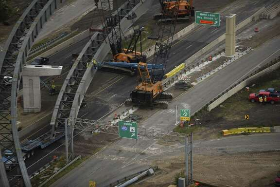 Crews work on steel beams at U.S. 90 at Loop 410 on Saturday, Nov. 11, 2017.