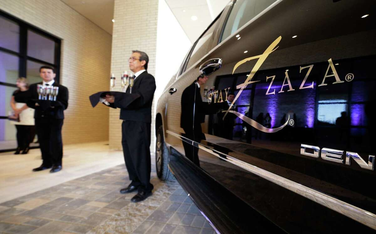 Champagne served at the lobby entrance next to the limousines at the new Hotel ZaZa in Houston Nov. 14, 2017, in Houston, TX. (Michael Wyke / For the Chronicle)