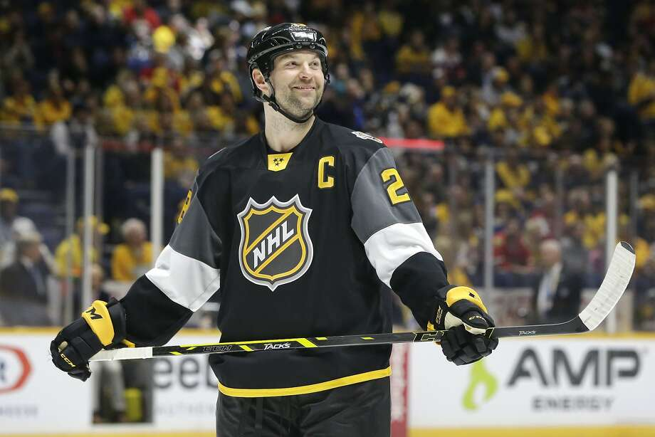 FILE - In this Jan. 31, 2016, file photo, Pacific Division forward John Scott looks into the stands during the NHL hockey All-Star championship game against the Atlantic Division, in Nashville, Tenn. Enforcer turned NHL All-Star, Scott tried out acting, and it made him more nervous than fighting 250-pound rivals and playing in front of 20,000 fans. Maybe that's not his next career, but with a movie coming out, Scott is considering his next move. (AP Photo/Mark Humphrey, File) Photo: Mark Humphrey, Associated Press