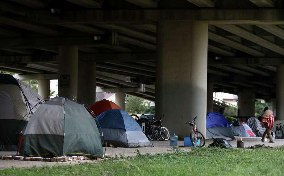 Tents dot a homeless encampment near downtown Houston. (Godofredo A. Vasquez / Houston Chronicle ) Photo: Godofredo A. Vasquez, Houston Chronicle / Godofredo A. Vasquez