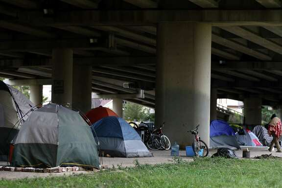 Tents dot a homeless encampment near downtown Houston. (Godofredo A. Vasquez / Houston Chronicle )