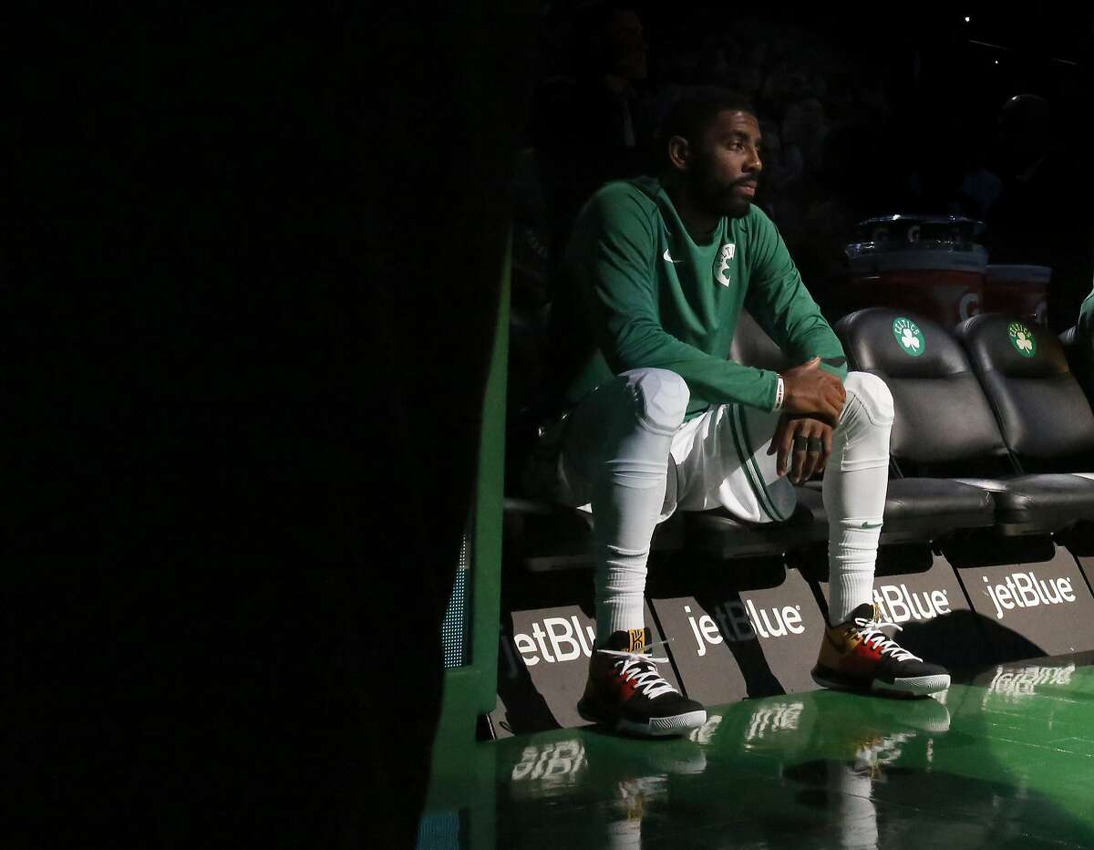 Boston Celtics' Kyrie Irving (11) sits on the bench as he waits to be introduced before the start of an NBA basketball game against the Sacramento Kings in Boston, Wednesday, Nov. 1, 2017. (AP Photo/Mary Schwalm)
