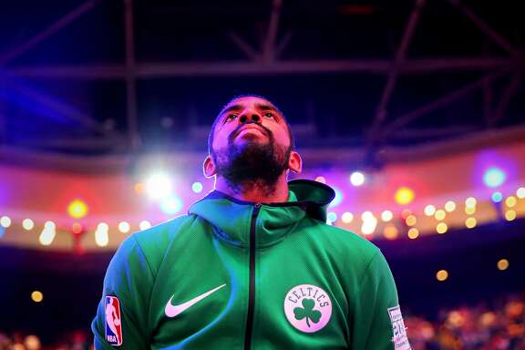 BOSTON, MA - OCTOBER 24: Kyrie Irving #11 of the Boston Celtics looks on during the singing of the national anthem before the game against the New York Knicks at TD Garden on October 24, 2017 in Boston, Massachusetts. (Photo by Maddie Meyer/Getty Images)