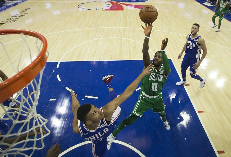 PHILADELPHIA, PA - OCTOBER 20: Kyrie Irving #11 of the Boston Celtics shoots the ball against Timothe Luwawu-Cabarrot #7 of the Philadelphia 76ers in the second quarter at the Wells Fargo Center on October 20, 2017 in Philadelphia, Pennsylvania. The Celtics defeated the 76ers 102-92. NOTE TO USER: User expressly acknowledges and agrees that, by downloading and or using this photograph, User is consenting to the terms and conditions of the Getty Images License Agreement. (Photo by Mitchell Leff/Getty Images) Photo: Mitchell Leff, Getty Images