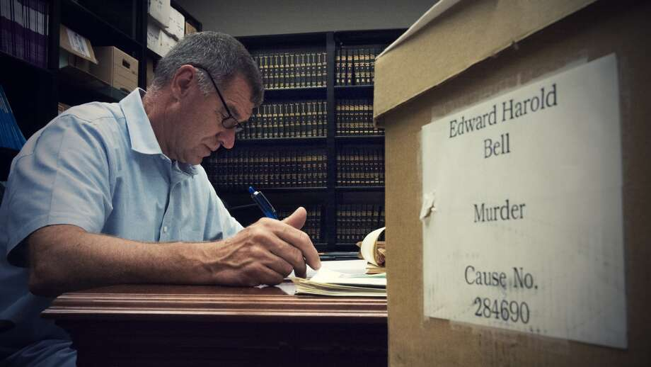 Do the secrets to who killed 11 girls in the greater Houston region in the 1970s lie inside old evidence boxes? In this photo: Retired detective Fred Paige pores over documents.