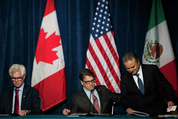 U.S. Department of Energy Secretary Rick Perry welcomes Secretary of Energy P. Joaquin Coldwell, right, of Mexico and Minister of Natural Resources Jim Carr of Canada during the North American Energy Ministerial, Tuesday, Nov. 14, 2017, in Houston. ( Marie D. De Jesus / Houston Chronicle )