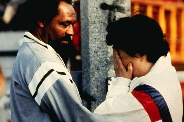 """A scene from Dan Lindsay and TJ Martin's docmentary """"LA 92,"""" about the riots in Los Angeles that followed the verdicts in the Rodney King beating case. Here, a black community member comforts a Korean store owner."""